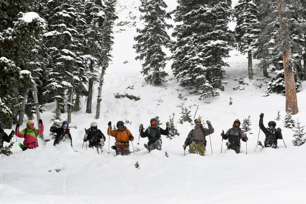 Ski boot packers stay in lines as they work their way down out-of-bounds ski terrain, above the popular Paradise Bowl area, as they stomp snow with their boots to help stabilize recent snowfall on January 10, 2018 at Crested Butte ski area in Crested Butte. Crested Butte Ski Patrol works with the boot packers to help mitigate out of bounds areas for avalanche control.