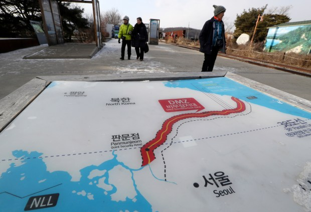 Visitors walk by a map of North and South Korea at the Imjingak Pavilion in Paju, South Korea, on Jan. 9. North Korea agreed Tuesday to send a delegation to next month's Winter Olympics in South Korea, Seoul officials said, as the bitter rivals sat for rare talks at the border to discuss how to cooperate in Olympics and improve their long-strained ties.