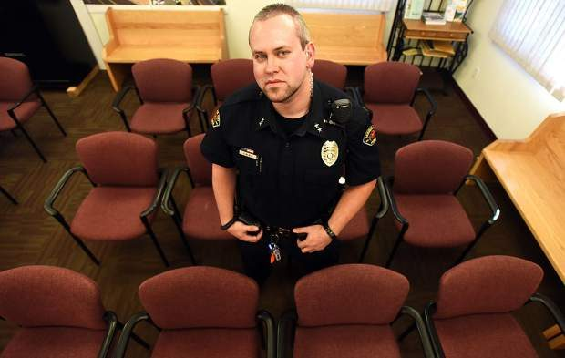 Garden City Police Chief Jeremy Black stands in the courtroom of the Garden City Town Hall on Thursday. Black, a former Weld County Sheriff's deputy, leads the new Garden City police force.