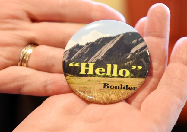 """Jenny Doyle is distributing these """"Hello"""" buttons to remind her fellow Boulderites that, while Boulder has been named the nation's happiest city, it's not always the friendliest."""