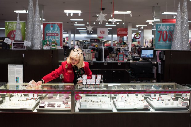 Barbara Cake cleans the counter toward the end of her shift at the J.C. Penney in Hermitage, Pennsylvania, on Dec. 23, 2017.