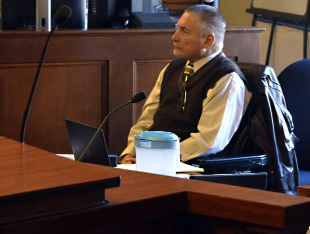 Greeley City Councilman Eddie Mirick listens during a court hearing Tuesday. Weld District Judge Marcelo Kopcow on Thursday ruled Mirick is ineligible to serve on the city council because of a 40-year-old felony conviction on his record.