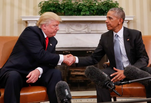 President Barack Obama and President-elect Donald Trump shake hands following their meeting in the Oval Office of the White House on Nov. 10, 2016.