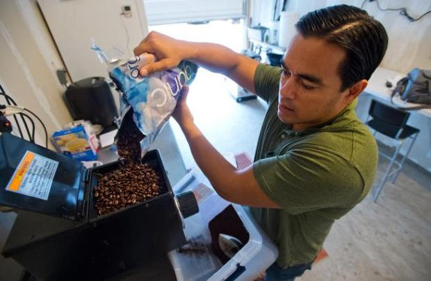 Jason Walsh pours coffee beans into a grinder as he begins to cold brew coffee at his home in Louisville in 2016. Walsh tapped a consultant for help getting his hemp-infused nitro cold brew coffee Native Jack online.