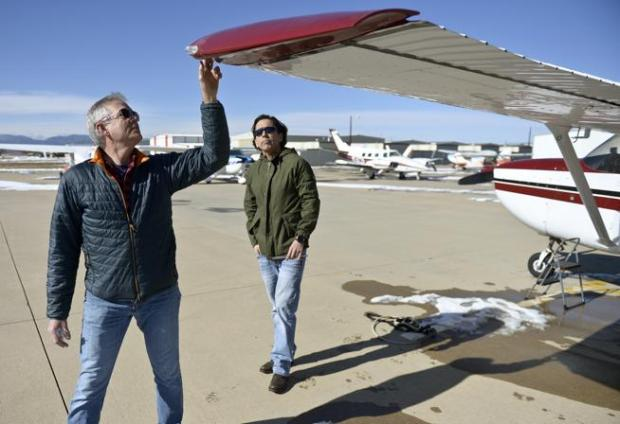 Flight instructor Mike Rider, left, does a preflight check with student Alex Flores at Vance Brand Municipal Airport in Longmont on Monday afternoon.