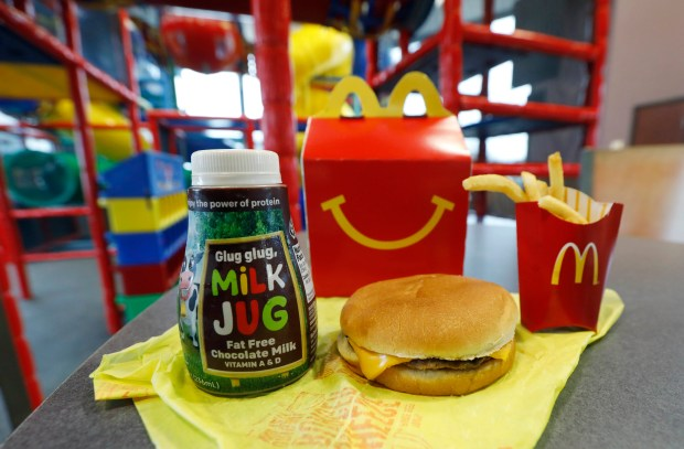 McDonald's is banishing cheeseburgers and chocolate milk from its Happy Meal menu. Diners can still ask specifically for cheeseburgers or chocolate milk with the kid's meal, but the fast-food company said that not listing them will reduce how often they're ordered.