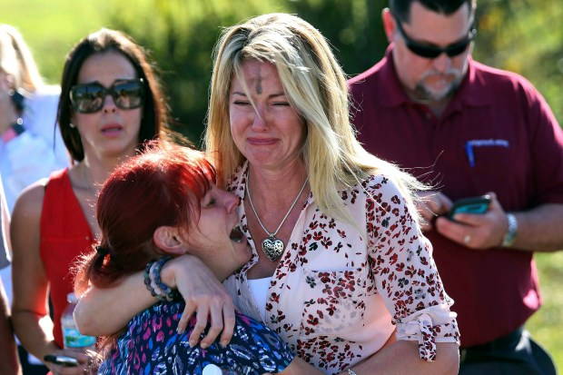 Parents wait for news after Wednesday's mass shooting at Marjory Stoneman Douglas High School in Parkland, Fla.
