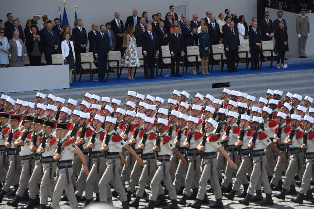 President Donald Trump, French President Emmanuel Macron and others attend a Bastille Day parade in Paris on July 14, 2017. At Trump's request, U.S. officials have begun to plan a grand military parade later this year showcasing the might of America's armed forces.