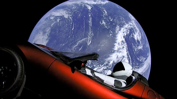 This image from video provided by SpaceX shows the company's spacesuit in Elon Musk's red Tesla sports car, which was launched into space during the first test flight of the Falcon Heavy rocket on Tuesday.