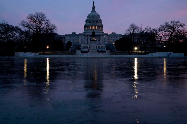 """The U.S. Capitol is seen at sunrise last Friday. Congress is preparing for a major debate over immigration, including whether to protect young """"Dreamers"""" from deportation, in an election-year battle that's sure to electrify both parties' most fervent voters and could well end in stalemate."""