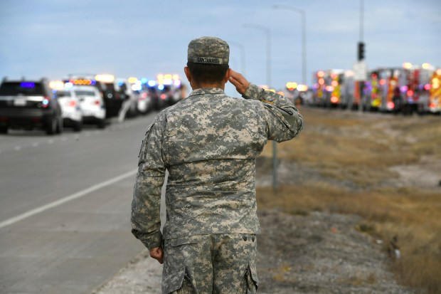 Army Sgt. William Garcia-Mayen salutes as the funeral procession for Douglas County sheriff's Deputy Zackari Parrish passes by on Interstate in Castle Pines on Jan. 5. Parrish was shot and killed while responding to a call on Dec. in Highlands Ranch. Since then, two more Colorado sheriff's deputies have been shot and killed in the line of duty.