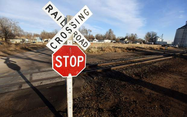A railroad crossing sign sits at the intersection where Kennedi Ingram was killed in a traffic crash involving a train Tuesday night in Eaton.