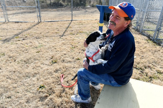 PAAS kennel technician Doug Randall, plays with Mazie, a recent arrival, at PAAS on Feb. 13, 2018 in Vinita, Oklahoma.