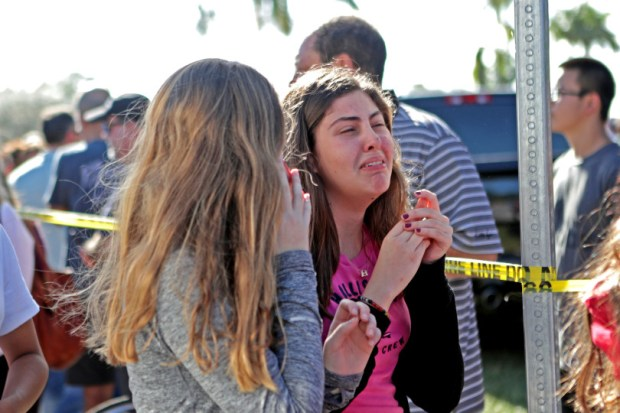 Students released from a lockdown are overcome with emotion following following Wednesday's shooting at Marjory Stoneman Douglas High School in Parkland, Fla.