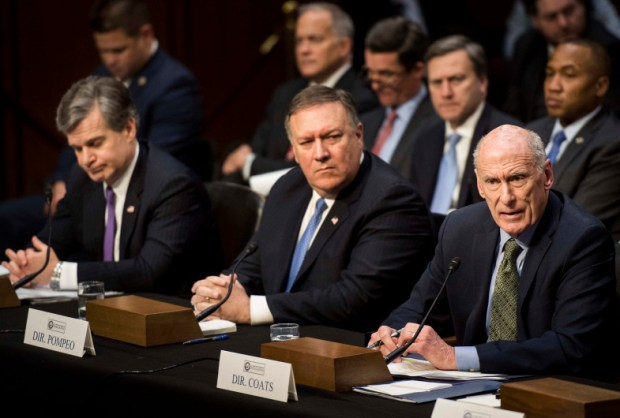 FBI Director Christophe Wrayr, CIA Director Mike Pompeo and Director of National Intelligence Daniel Coats testify before the Senate Intelligence Committee on Tuesday. The intelligence chiefs told Congress that Russia is continuing its efforts to disrupt U.S. politics and is targeting this year's midterm elections.