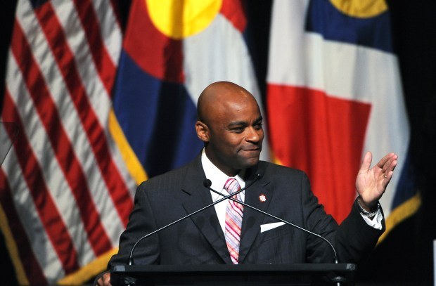 Michael Hancock speaks after being sworn in as Denver's 45th mayor on July 18, 2011. Hancock acknowledged this week that he sent suggestive text messages to a female police officer on his security detail during his first year in office. The officer said in a recent interview that she considered the messages to be sexual harassment.