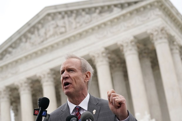 Illinois Gov. Bruce Rauner speaks to the media in front of the U.S. Supreme Court after a hearing on Feb. 26. The court listened to the case of Janus vs. AFSCME to determine whether states violate their employees' First Amendment rights to require them to join public-sector unions which they may not want to associate with.