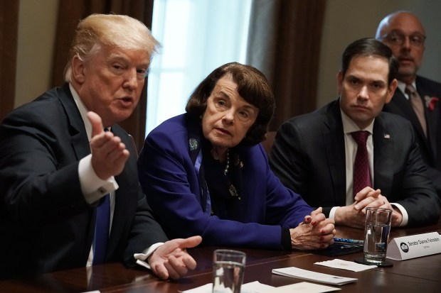 President Donald Trump speaks as Sen. Dianne Feinstein, Sen. Marco Rubio and Rep. Ted Deutch listen during a meeting discuss school and community safety on Feb. 28 at the White House.