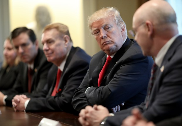 President Donald Trump listens during a meeting with leaders of the steel and aluminum industries at the White House on March 1. Trump announced planned tariffs on imported steel and aluminum during the meeting.