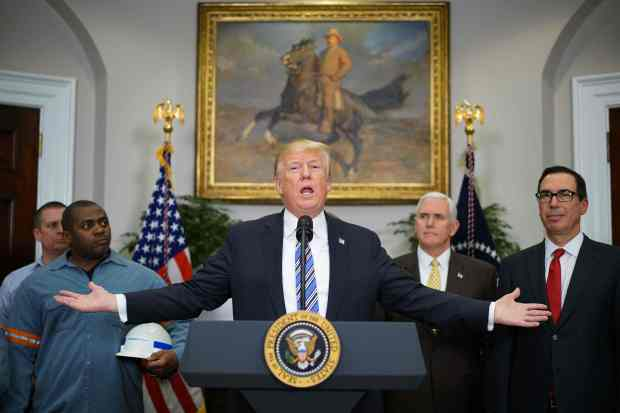 President Donald Trump speaks before signing Section 232 proclamations on steel and aluminum imports in the Roosevelt Room of the White House on Thursday.