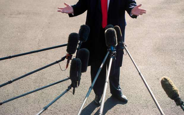 President Donald Trump speaks to the media Tuesday outside the White House.
