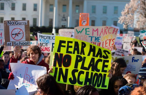 Students protest in front of the White House as part of a nationwide student walkout for gun control on Wednesday.