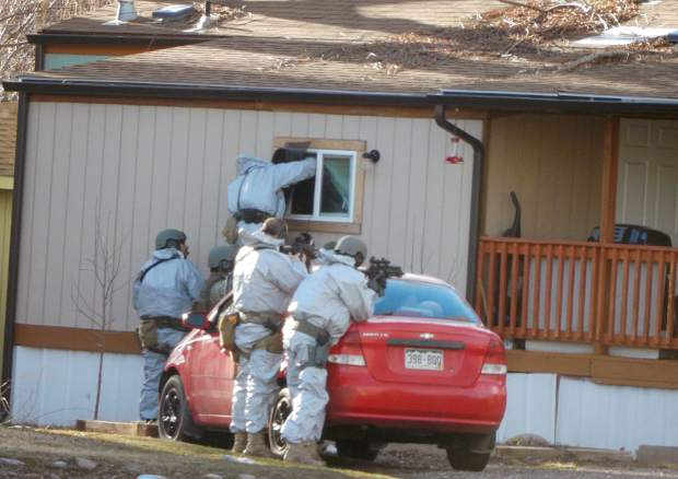 Members of the All-Hazards Response Team from Garfield County check a window of a residence at the Roaring Fork Mobile Home Park in Basalt Friday. They checked to make sure it was free of hazardous materials from possible drug making before Basalt police executed a search warrant.