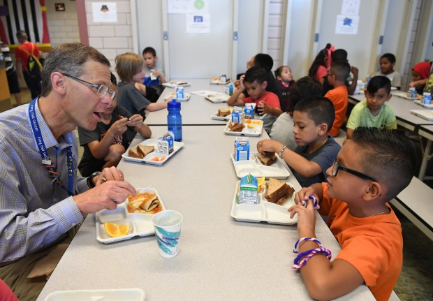 Denver Public Schools Superintendent Tom Boasberg eats lunch with students during a summer camp at Cowell Elementary School on July 18, 2016.