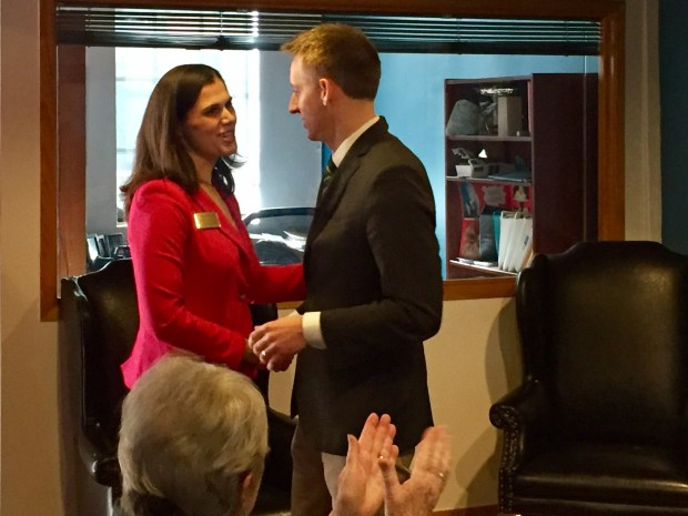 Jena Griswold, a Democratic candidate for Colorado secretary of state, greets former Missouri Secretary of State Jason Kander during a fundraising event on March 12, 2018, in Denver.