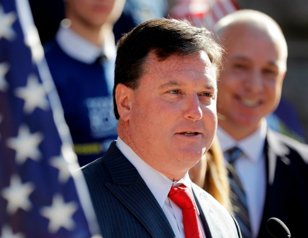 In this Aug. 9, 2017, file photo, Indiana Rep. Todd Rokita speaks during a news conference outside of the Indiana Statehouse in Indianapolis. Donald Trump's re-election campaign is demanding that Rokita take down yard signs giving the false impression the president endorsed the Indiana Republican's Senate bid.