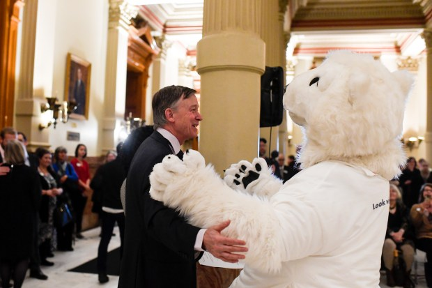 DENVER, CO - APRIL 24: Colorado Gov. John Hickenlooper embraces Popsicle the Polar Bear before proclaiming April 24 as the 30-year anniversary for the Scientific & Cultural Facilities District at the Colorado State Capitol on Tuesday, April 24, 2018. The final day of this session of the legislature is May 9, 2018. (Photo by AAron Ontiveroz/The Denver Post)