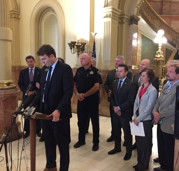 "House Assistant Majority Leader Alec Garnett, front, announces a new ""red flag"" measure to allow judges to seize firearms from people who are considered a risk. He is joined by other supporters of the measure at a press conference at the Colorado Capitol on April 30, 2018."