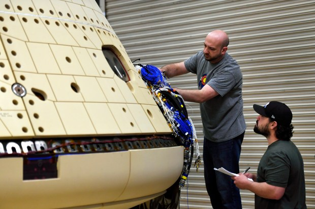 Technicians working on the Orion Structural ...