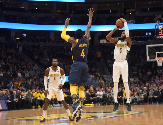 DENVER, CO APRIL 3: Denver Nuggets forward Will Barton (5) takes a shot over Indiana Pacers guard Victor Oladipo (4) during the first quarter on April 3, 2018 at Pepsi Center. (Photo by John Leyba/The Denver Post)