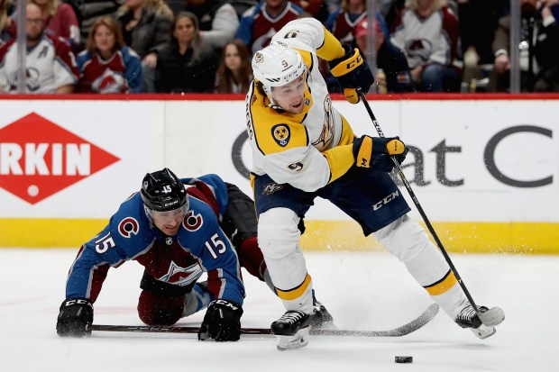 DENVER, CO - APRIL 18: Filip Forsberg #9 of the Nashville Predators breaks free from Duncan Siemans #15 of the Colorado Avalanche in Game Four of the Western Conference First Round during the 2018 NHL Stanley Cup Playoffs at the Pepsi Center on April 18, 2018 in Denver, Colorado. (Photo by Matthew Stockman/Getty Images)