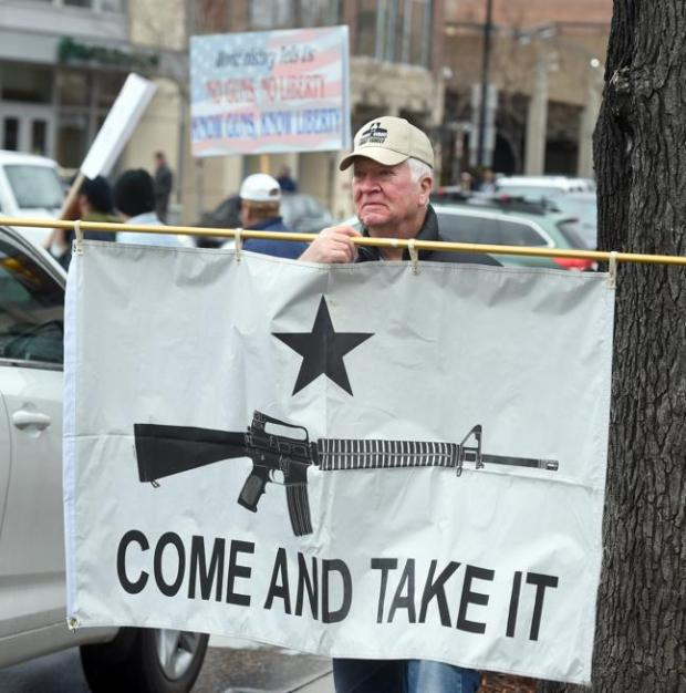 A man named Steve joins about 200 gun supporters at a rally in downtown Boulder on April 21.