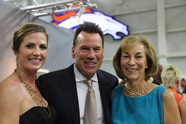Steering committee chair Beth Bowlen Wallace, left, with Denver Broncos head coach Gary Kubiak and Alzeheimer's Association president Linda Mitchell.