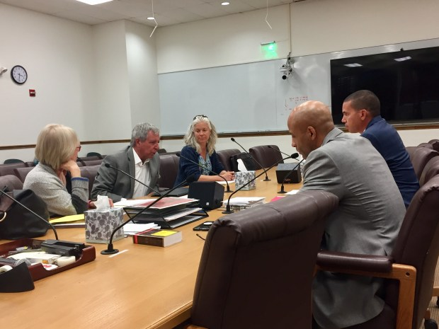 Christine O'Connor (left), Larry Ambrose and Marie Benedix of the NOlympics Colorado Committee answer questions posed by Denver City Council executive director Leon Mason (second from right) and Troy Bratton, the deputy legislative counsel, during a voter initiative review and comment meeting on May 1, 2018, in the City and County Building.