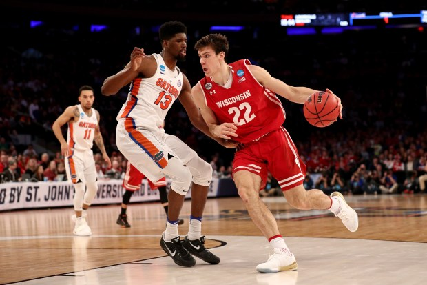 Ethan Happ (22) of the Wisconsin Badgers drives to the basket against Kevarrius Hayes (13) of the Florida Gators during the 2017 NCAA Men's Basketball Tournament East Regional at Madison Square Garden on March 24, 2017 in New York City.