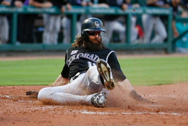 Colorado Rockies' Charlie Blackmon scores on ...