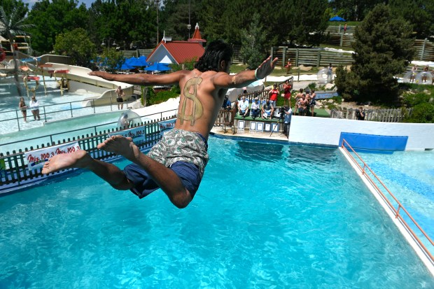 Nikko Bermea dives off the high ...