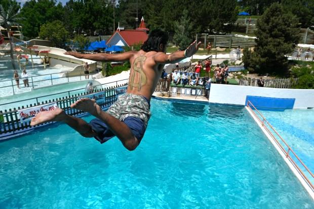 Nikko Bermea dives off the high ...