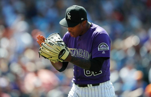 Colorado Rockies relief pitcher Yenoy Almonte reacts after getting New York Mets pinch-hitter Devin Mesoraco to hit into a double play to end the top of the eighth inning of a baseball game Thursday, June 21, 2018, in Denver. The Rockies won 6-4.