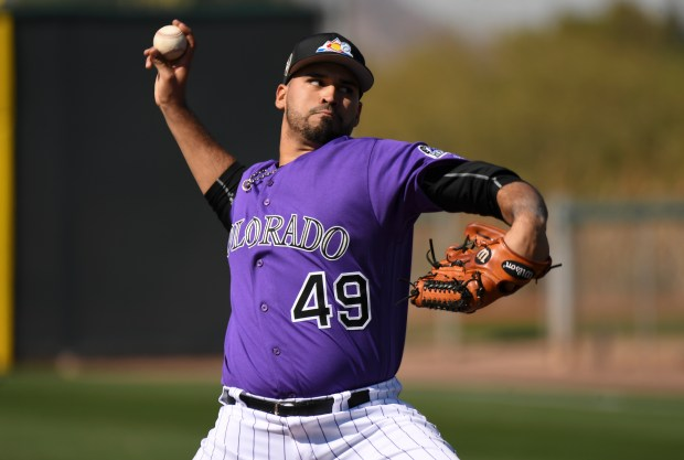 Colorado Rockies starting pitcher Antonio Senzatela (49) delivers a pitch during batting practice on Feb. 21, 2018 at Salt River Fields at Talking Stick in Scottsdale, Ariz.