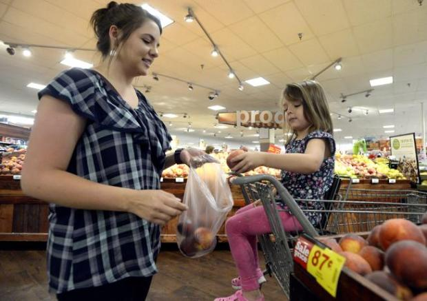 Alysa Dudrey and her five-year-old daughter Evalyn shop for groceries on Thursday at the King Soopers in Longmont. A petition seeking support for exempting food bought at grocery stores for at-home consumption from Longmont municipal sales taxes was approved by the city clerk's office for circulation Thursday.