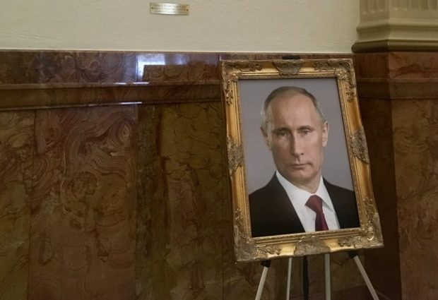 A prank left Vladimir Putins portrait in the place of Donald Trumps at the Colorado Capitols wall of presidential portraits.