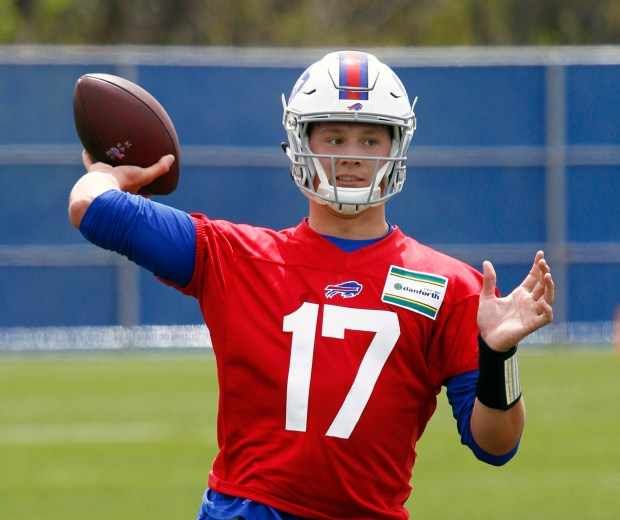 In this May 11, 2018, file photo, Buffalo Bills rookie quarterback Josh Allen throws a pass during the team's NFL football rookie minicamp, in Orchard Park, N.Y.