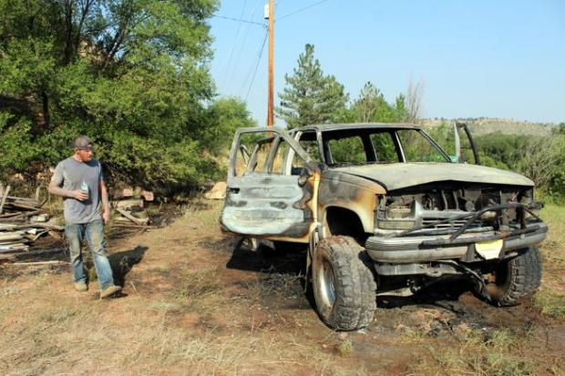 Tim Wingate assesses the damage to his 1997 Chevrolet Suburban project car, which caught fire Wednesday near U.S. 34 west of Loveland.