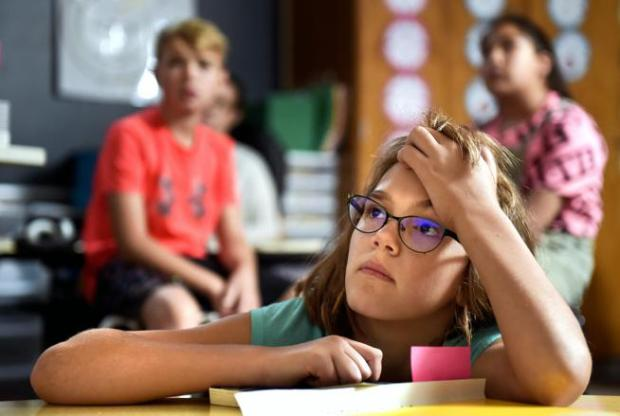 Jaydin Lombardie watches a music video Monday in her classroom at Burlington Elementary School. Jaydin is in the fifth grade. The state released school accreditation ratings Monday.