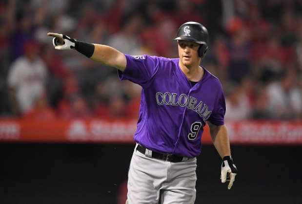 Colorado Rockies' DJ LeMahieu gestures toward ...